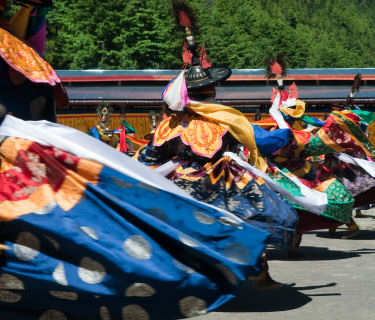 Bhutan costumed dancers in traditional festival